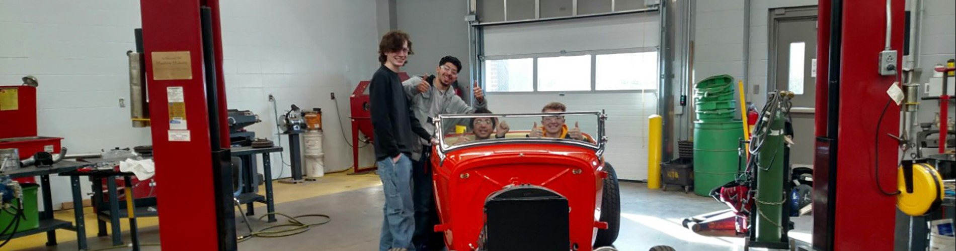 Automotive students in hot rod car