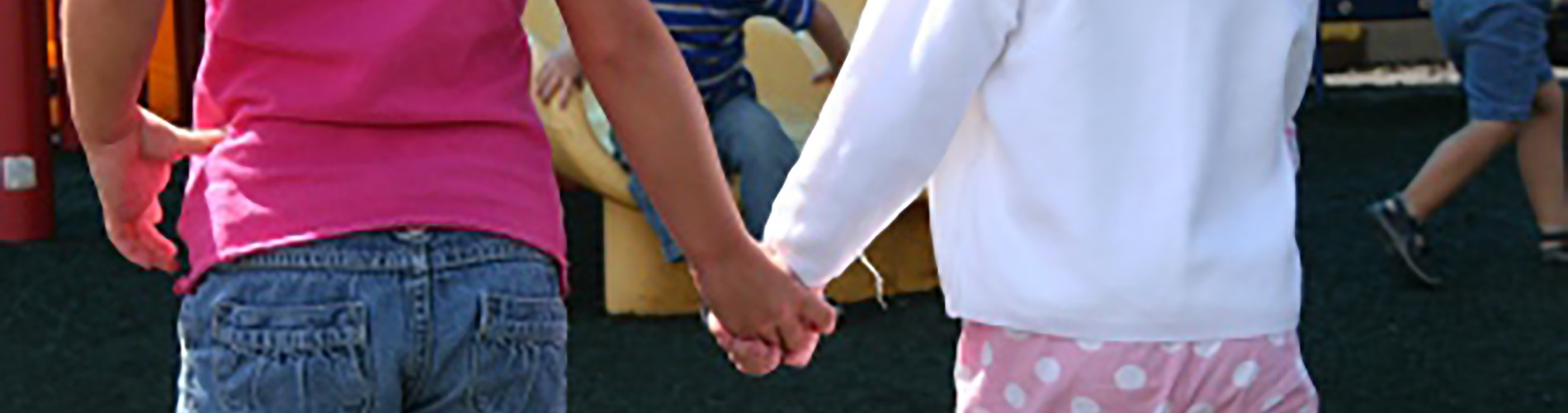 Two Oldham County Preschool students holding hands